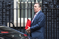 © Licensed to London News Pictures. 26/03/2019. London, UK. Secretary of State for International Trade Liam Fox arrives on Downing Street for the Cabinet meeting. MPs have passed an amendment which gives Parliament a series of indicative votes on alternatives to Prime Minister Theresa May's Brexit deal. Photo credit: Rob Pinney/LNP