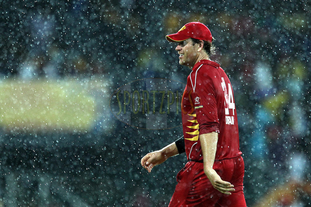 Jacob Oram leaves the field during the rain break during the Final Match of the Sri Lankan Premier League between Uva Next and Nagenahira Nagas held at the Premadasa Stadium in Colombo, Sri Lanka on the 31st August 2012. .Photo by Ron Gaunt/SPORTZPICS/SLPL
