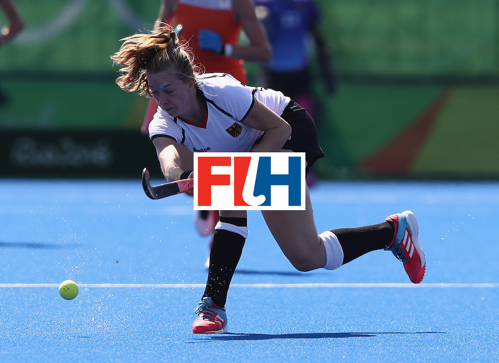 RIO DE JANEIRO, BRAZIL - AUGUST 13:  Franzisca Hauke of Germany passes the ball during the Women's group A hockey match between the Netherlands and Germany on Day 8 of the Rio 2016 Olympic Games at the Olympic Hockey Centre on August 13, 2016 in Rio de Janeiro, Brazil.  (Photo by David Rogers/Getty Images)