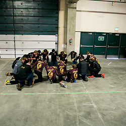 The Moses Lake high school wrestling team prays together before opening matches on the first day of the Rollie Lane Invitational held at the Ford Idaho Center in Nampa, Idaho. Friday January 8, 2016
