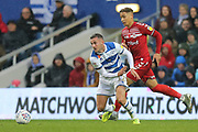 Queens Park Rangers defender Dominic Ball (12) challenged by Middlesbrough midfielder Marcus Tavernier (7) during the EFL Sky Bet Championship match between Queens Park Rangers and Middlesbrough at the Kiyan Prince Foundation Stadium, London, England on 9 November 2019.