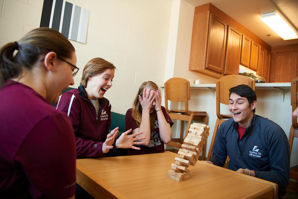 Activity; Playing; Relaxing; Socializing; Smiling; Buildings; Dorm; Residence Dorm; Reuter Hall; Location; Inside; Objects; Eagle L; board game; People; RA Resident Assistant; Student Students; Woman Women; Man Men; Type of Photography; Candid; UWL UW-L UW-La Crosse University of Wisconsin-La Crosse; Winter; February