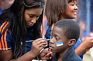General view of the exterior of the stadium showing a young Real Madrid fan having face paint applied in the club's colours pictured ahead of the UEFA Champions League Final at Estádio da Luz, Lisbon<br /> Picture by Ian Wadkins/Focus Images Ltd +44 7877 568959<br /> 24/05/2014