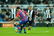 James Tomkins (#5) of Crystal Palace wins the ball from Joelinton (#9) of Newcastle United during the Premier League match between Newcastle United and Crystal Palace at St. James's Park, Newcastle, England on 21 December 2019.