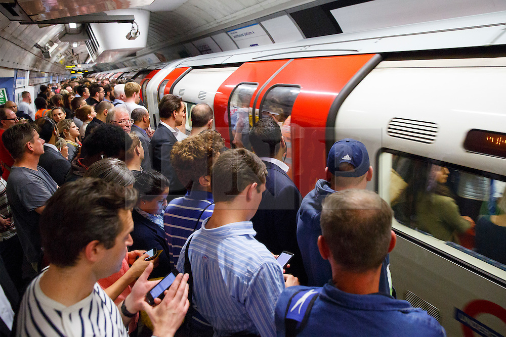 © Licensed to London News Pictures. 08/07/2015. London, UK. Commuters queuing for Victoria line trains at Green Park Tube station ahead of the Tube strike in the evening rush hour of Monday, July 8, 2015. The strike will be a 27-hour stoppage by about 20,000 Tube staff to shut down the entire London Underground network. Photo credit: Tolga Akmen/LNP