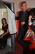 Tracey Emin in the Art Fund Centenary Photo Me machine. Art 2003 London Art Fair opening. Business Design Centre.  14 January 2003. © Copyright Photograph by Dafydd Jones 66 Stockwell Park Rd. London SW9 0DA Tel 020 7733 0108 www.dafjones.com