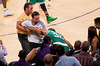17 June 2010: Center Rasheed Wallace of the Boston Celtics is helped up by fans after falling into the seats while playing against the Los Angeles Lakers during the second half of the Lakers 83-79 championship victory over the Celtics in Game 7 of the NBA Finals at the STAPLES Center in Los Angeles, CA.