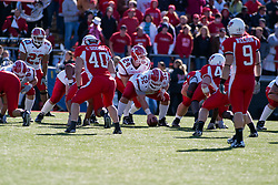 28 October 2006: Penguin offense and Redbird defense line up to play. Players include: Marcus Mason,Tom Zetts, Ryan Jewell, Cameron Siskowic, Tom Nelson and Nhemie Theodore. Youngstown State turned off over 15,000 fans as the win blew their way, cooling off Illinois State 27-13. Nationally ranked teams Youngstown State Penguins and Illinois State Redbirds competed at Hancock Stadium on the campus of Illinois State University in Normal Illinois.