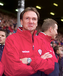 LIVERPOOL, ENGLAND - Sunday, November 4, 2001: Liverpool's caretaker manager Phil Thompson admires the Kop's tribute to manager Gerard Houllier during the Premiership match at Anfield. (Pic by David Rawcliffe/Propaganda)