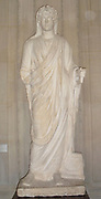 Marble statue of Antinous as deified priest. One of Hadrian's closest companions who was deified in many statues after his death, and for whom a cult formed in his name. This statue is from Cyreme in Libya. In it his head is covered with a piece of his robe, as he presides over a sacrifice in honour of the emperor.