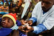 Vaccinator Bala Diakite vaccinates a child in the village of Banankoro, Mali on Saturday August 28, 2010.
