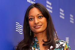 "Edinburgh, Scotland, UK. 26 August, 2018. Pictured; Dharshini David the economist and broadcaster. Her book ""The Almighty Dollar"" followed the money finding that globalisation would buckle without the vast reserves of dollars circulating, even aside from the enormous numbers of dollars kept in vaults by some countries."