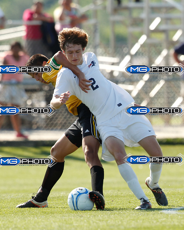 May 10, 2014; Huntsville, AL, USA;  Home wood William Jackson (2) is pushed away by Fort Payne during the 5A Boys State Soccer Championship at John Hunt Soccer Complex. Mandatory Credit: Marvin Gentry