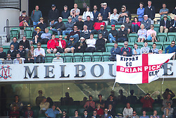 © Licensed to London News Pictures. 27/12/2013. England fans place their flag over the Melbourne Cricket Club signage in the members stand during Day 2 of the Ashes Boxing Day Test Match between Australia Vs England at the MCG on 27 December, 2013 in Melbourne, Australia. Photo credit : Asanka Brendon Ratnayake/LNP
