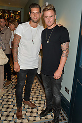 Left to right, cricketers JADE DERNBACH and JASON ROY at the launch of Give Me Sport Magazine held at Library, 112 St.Martin's Lane, London on 30th July 2014.