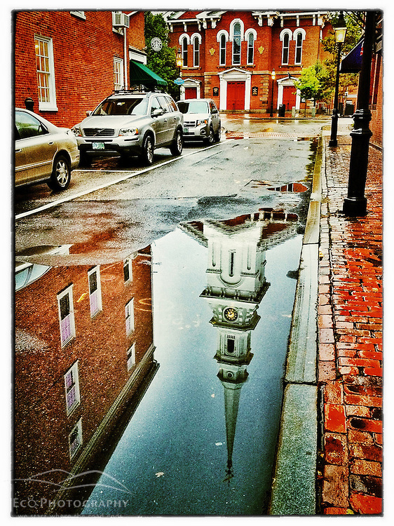 "The North Church reflected in a puddle in Portsmouth, New Hampshire. iPhone photo - suitable for print reproduction up to 8"" x 12""."