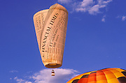 Financial Times hot air balloon rising in dawn light at the International Balloon Fiesta, Albuquerque, New Mexico