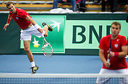 (L) Mariusz Fyrstenberg & (R) Marcin Matkowski both from Poland compete at men's double game during second day of the BNP Paribas Davis Cup 2013 between Poland and South Africa at MOSiR Hall in Zielona Gora on April 06, 2013...Poland, Zielona Gora, April 06, 2013..Picture also available in RAW (NEF) or TIFF format on special request...For editorial use only. Any commercial or promotional use requires permission...Photo by © Adam Nurkiewicz / Mediasport