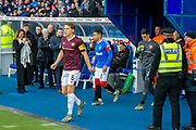 Christophe Berra (#6) of Heart of Midlothian FC leads out the Hearts team before the Ladbrokes Scottish Premiership match between Rangers FC and Heart of Midlothian FC at Ibrox Park, Glasgow, Scotland on 1 December 2019.
