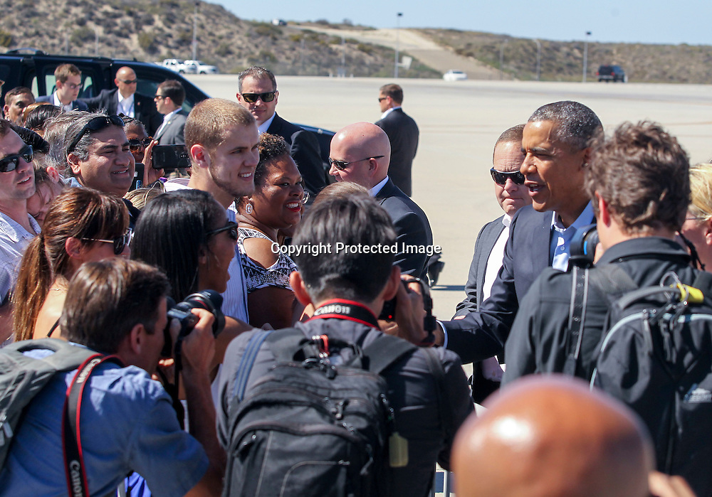 President Barack Obama greets with a small crowd after his arrival at Los Angeles International Airport in Los Angeles on Saturday, Oct. 10, 2015. (AP Photo/Ringo H.W. Chiu)