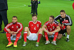 LILLE, FRANCE - Friday, July 1, 2016: Wales' Ashley 'Jazz' Richards, Ben Davies, Chris Gunter and sports science coach Adam Owen celebrate after a 3-1 victory over Belgium and reaching the Semi-Final during the UEFA Euro 2016 Championship Quarter-Final match at the Stade Pierre Mauroy. (Pic by David Rawcliffe/Propaganda)