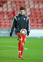 WREXHAM, WALES - Tuesday, November 17, 2015: Wales' Callum Saunders warms-up before the UEFA Under-21 Championship Qualifying Group 5 match against Romania at the Racecourse Ground. (Pic by David Rawcliffe/Propaganda)