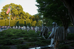 Korean Veterans War Memorial, National Mall and Memorial Parks, Washington, DC, June 3, 2008...The Korean War Veterans Memorial is located in Washington, D.C.'s West Potomac Park, southeast of the Lincoln Memorial and just south of the Reflecting Pool on the National Mall...The Korean War Veterans Memorial was authorized by the U.S. Congress (Public Law 99-572) on October 28, 1986, with design and construction managed by the Korean War Veterans Memorial Advisory Board and the American Battle Monuments Commission. President George H. W. Bush conducted the groundbreaking for the Memorial on June 14, 1992, Flag Day. It was dedicated on July 27, 1995, the 42nd anniversary of the armistice that ended the war, by President Bill Clinton and Kim Young Sam, President of the Republic of Korea, to the men and women who served during the conflict. Management of the memorial was turned over to the National Park Service, under its National Mall and Memorial Parks group. As with all National Park Service historic areas, the memorial was administratively listed on the National Register of Historic Places on the day of its dedication.