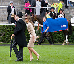 © licensed to London News Pictures.16/06/2011. Ascot, UK.  Liz Hurley leaves the winners enclosure after watching her horse Census fail to make a place on Ladies day at Royal Ascot races today (16/06/2011). The 5 day showcase event is one of the highlights of the racing calendar. Horse racing has been held at the famous Berkshire course since 1711 and tradition is a hallmark of the meeting. Top hats and tails remain compulsory in parts of the course. Photo credit should read: Ben Cawthra/LNP