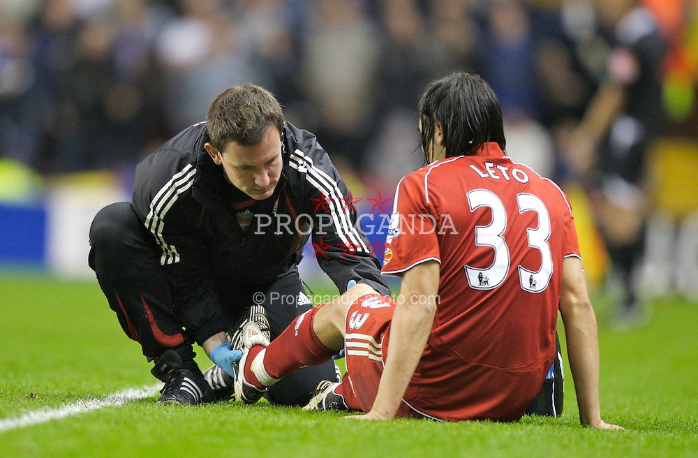 LIVERPOOL, ENGLAND - Wednesday, October 31, 2007: Liverpool's senior physiotherapist Rob Price checks on injured team-mate Sebastian Leto during the League Cup 4th Round match against Cardiff City at Anfield. (Photo by David Rawcliffe/Propaganda)