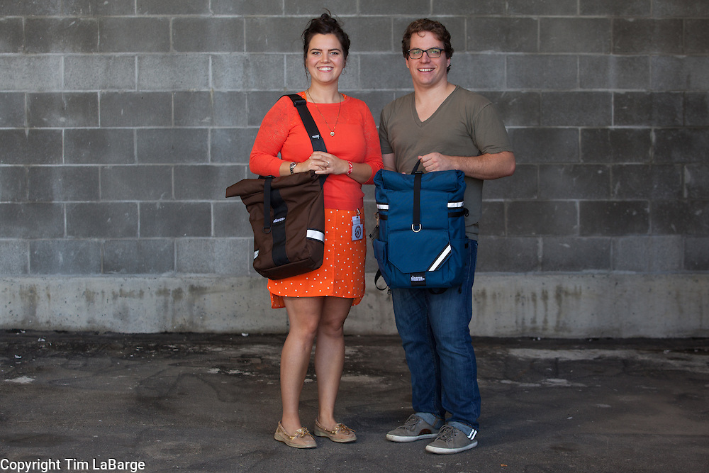 Elizabeth Clarkson and Curtis Williams of North St. Bags at the Handmade Bike and Beer Festival at Hopworks Urban Brewery in Portland, Oregon. Image by Tim LaBarge