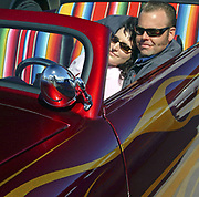 A couple of Rockabillies chilling in a 50's style car, a red Hotrod, Viva Las Vegas Festival, Las Vegas, USA 2006.
