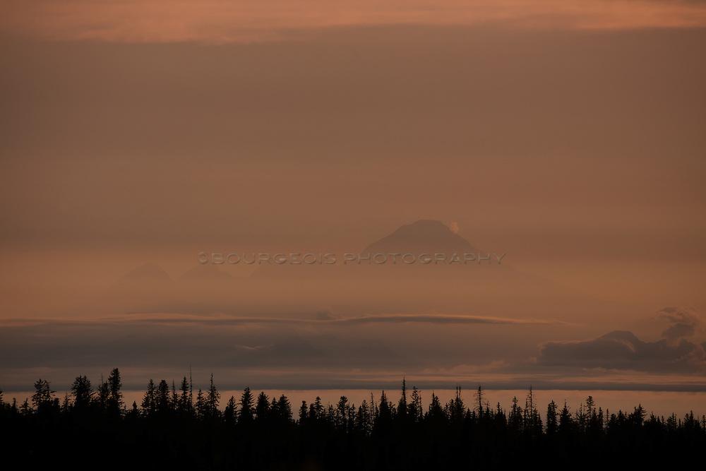 Smoke pours out of the top of MT. Redoubt near Alaska's Kenai Peninsula. This shot was taken from Homer, Alaska.