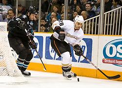 January 21, 2010; San Jose, CA, USA; Anaheim Ducks center Kyle Chipchura (28) skates past San Jose Sharks defenseman Kent Huskins (40) during the first period at HP Pavilion. San Jose defeated Anaheim 3-1. Mandatory Credit: Jason O. Watson / US PRESSWIRE