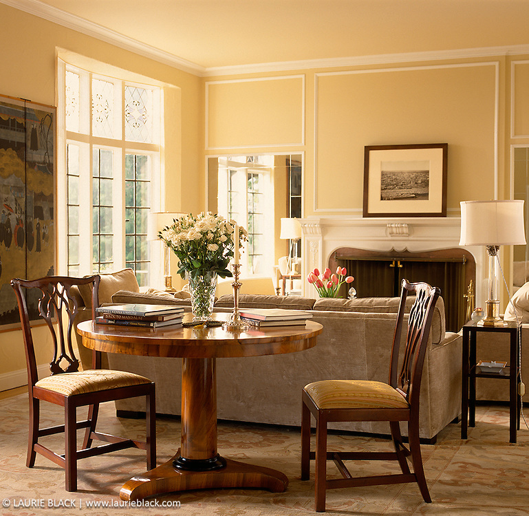 Sunny elegant living room and dining table.