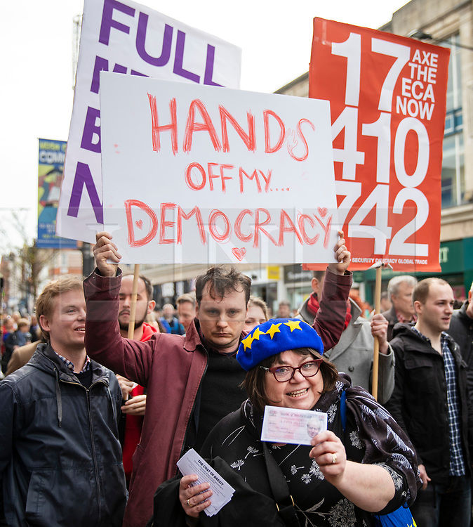 © Licensed to London News Pictures. 15/04/2018. London, UK. An EU supporter walks past pro-Brexit protesters outside Electric Ballroom in Camden at the launch event for the People's Vote campaign which is calling for a public vote on the final Brexit deal. Photo credit: Rob Pinney/LNP