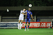 AFC Wimbledon striker Tyrone Barnett (23) and Plymouth Argyle midfielder Ben Purrington (16) during the EFL Trophy match between AFC Wimbledon and Plymouth Argyle at the Cherry Red Records Stadium, Kingston, England on 4 October 2016. Photo by Stuart Butcher.