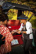 Rickshaw driver gets paid by woman after tour of Kyoto, Japan.