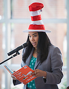 """Houston ISD Food Services Administration's Audene Chung reads, """"Green Eggs and Ham"""" to students celebrating Dr. Seuss Day and National Reading Day at the Rice School, March 3, 2014."""