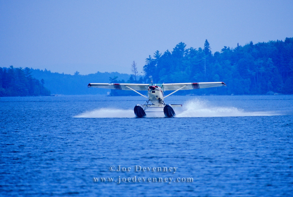 Seaplane landing on Moosehead Lake. Greenville , Maine