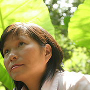 Conservationist Vu Thi Quyen amid the flora of Cuc Phuong National Park, 140 kilometers south of Hanoi, Vietnam. The 31-year-old Quyen started Vietnam's first domestic wildlife conservation group, Education for Nature Vietnam (ENV), four years ago. Now based in Hanoi, she is at the forefront of a growing movement to help Vietnamese understand the importance of conserving wildlife in one of Asia's most ecologically diverse nations. ..
