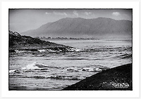 Looking across Point Briner towards Back Beach, the Macleay River mouth, and Mt Yarrahapinni in the distance. Grainy monochrome version. [South West Rocks, NSW]<br />