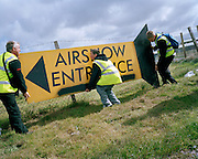 Organisers adjust sign before Caernafon air show by the 'Red Arrows', Britain's Royal Air Force aerobatic team.