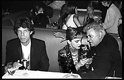 Mick Jagger, Madonna & Tony Curtis at the Vanity Fair Oscar Night Party.  Mortons. Los Angeles.  24 March 1997<br /> Copyright Photograph by Dafydd Jones<br /> 66 Stockwell Park Rd. London SW9 0DA<br /> Tel 0171 733 0108
