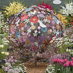 © licensed to London News Pictures. LONDON, UK  23/05/2011. A flower sculpture at the 2011 RHS Chelsea Flower Show. The show held each year in the grounds of the Royal Chelsea Hospital and organised by the Royal Horticultural society opens to the general public tomorrow and is already sold out. Please see special instructions for usage rates. Photo credit should read CLIFF HIDE/LNP