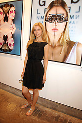 Model SOPHIA PUNCOCHAROVA in front of a photograph of her at the launch of 'Glenmorangie 5 Senses' an exhibition of photographs by Mike Figgis held at Proud Camden, Stables Market, London NW1 on 13th May 2008.<br />