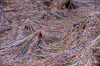 A mountainside covered with thousands of prayer flags, Drak Yerpa Monastery, Dagze, Tibet (Xizang), China.