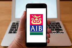 Using iPhone smartphone to display website logo of AIB, Allied Irish Bank