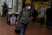 As the Coronovirus pandemic takes hold across the UK, with health authorities reporting cases rising from 25 to 87 in a single day, and resulting in the UK's chief medical officer Prof Chris Whitty announcing that an epidemic in the UK was 'highly likely', a man wearing a surgical mask passes-by Evening Standard headlines outside Embankment Underground station, on 4th March 2020, in London, England.