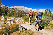 Backpackers on trail in Little Lakes Valley, John Muir Wilderness, Sierra Nevada Mountains, California USA