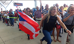 October 3, 2017 - Fort Lauderdale, Florida, U.S. - Families of Caribbean hurricane evacuees who arrived on board the Royal Caribbean Adventure of the Seas, rush to greet their relatives, Tuesday, at Port Everglades. More than 3,000 people from Puerto Rico and the U.S. Virgin Islands were brought to Florida on board the Royal Caribbean Adventure of the Seas.  (Credit Image: © Joe Cavaretta/Sun-Sentinel via ZUMA Wire)